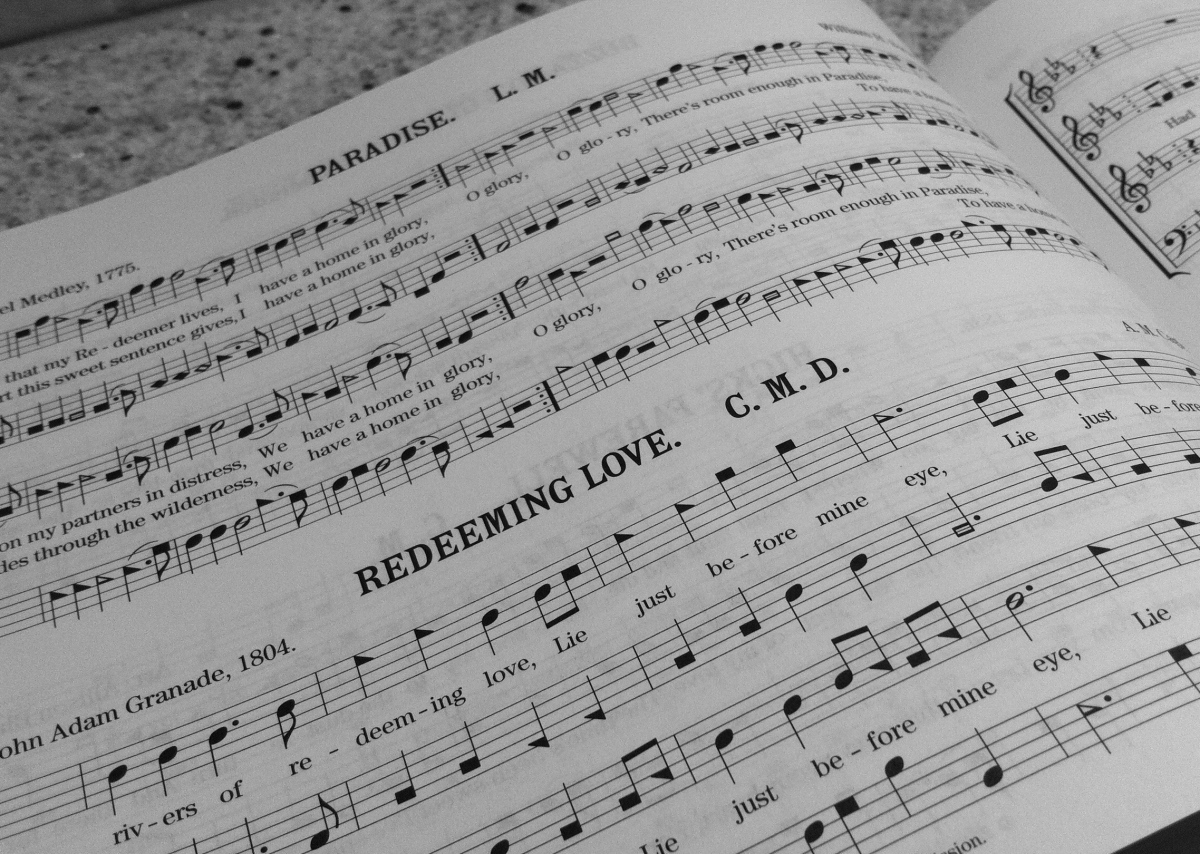 hymnal image with shaped notes on the page