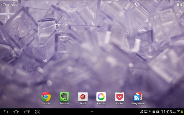 An ICS homescreen with a few app icons.